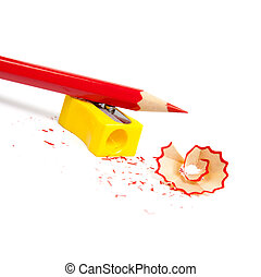 Sharpened pencil next to the sharpener and shavings