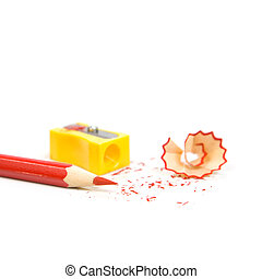 Sharpened pencil next to the sharpener and shavings.
