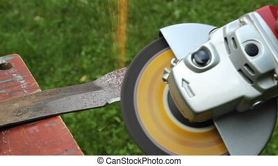 sharpening a lawnmower blade - using a hand grinder to...
