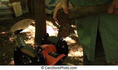 sharpening axe using a grinding machine HD
