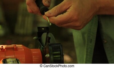 Sharpening side screwdriver on electrical grinding wheel HD