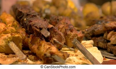Shashlik and steak. Cooked meat close up.