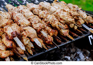 Shashlik on a barbecue grill over charcoal shish kebab popular in Eastern Europe