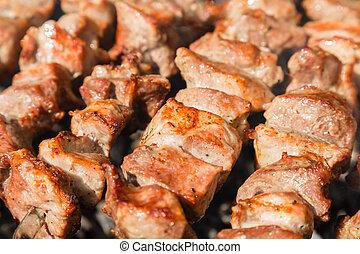 Shashlyk (kebab) grilling on the bbq