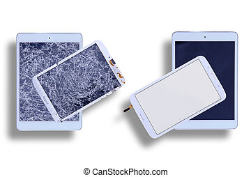 Shattered and repaired tablet screens - Overhead view of two...