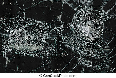 Shattered glass window with two holes...