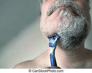 Shave - A man is starting to shave