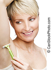 shave - young blond woman shaving close up shoot