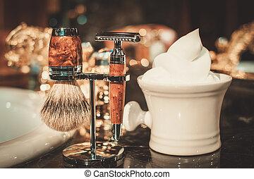 Shaving accessories in a luxury bathroom interior.