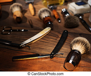 Shaving accessories on a luxury wooden background.