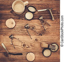 Shaving accessories on a on a luxury wooden board