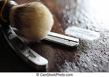 Shaving accessories on a wooden background