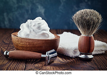 Shaving accessories on wooden background