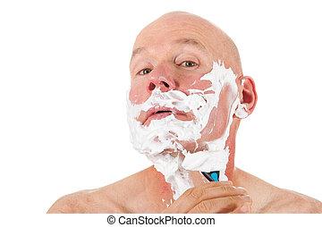 Shaving bald man