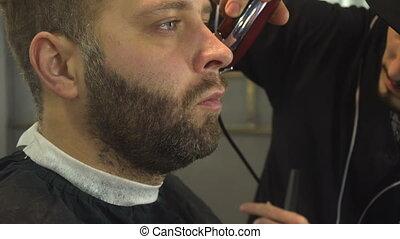 Shaving beard of man in barber shop - Shaving beard of man...