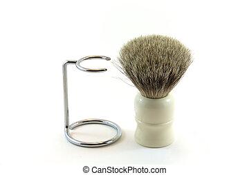 An old shaving brush beside a holder