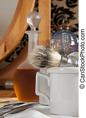 Shaving brush and antique bottles in a victorian barbershop