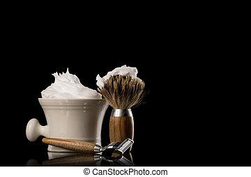Safety Razor and Shaving Brush on black Background