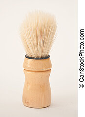 Close up imageof a shaving brush with foam