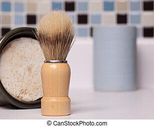 Closeup of a shaving brush and shaving soap