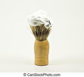 shaving brush, shaving foam, light colored background
