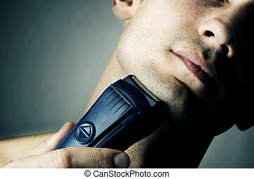 Shaving by electric shaver - Fashion portrait of male chin...