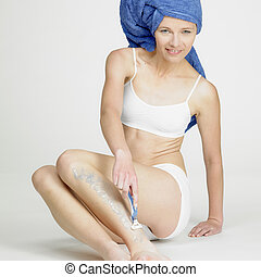 shaving woman with towel on head