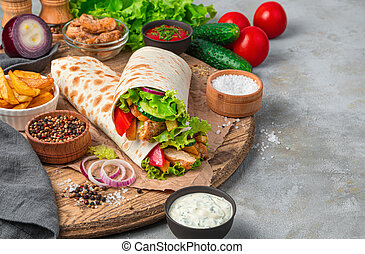 Shawarma and ingredients on a gray background with space to copy.