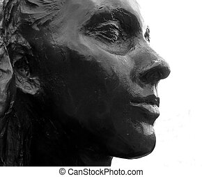 She - A woman face bronze statue