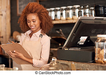She has her cafe running perfectly - Attractive young woman...