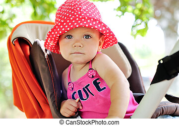 she is cute girl in the stroller