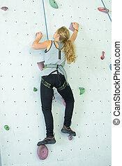 she is doing wall climbing