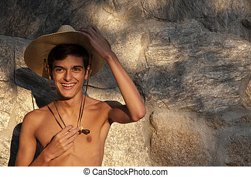 she is smiling young man with hat in summer