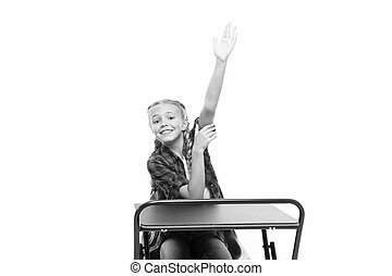 She is up on her homework. Adorable small child raising hand...