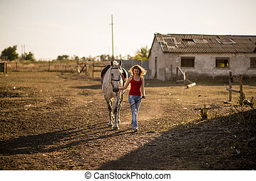 she leads a horse