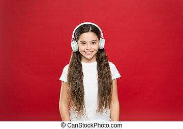 She loves the incredible sound of her headphones. Little girl listening to music. Cute small girl wearing stereo headphones. Adorable music fan. Little child enjoy music playing in earphones