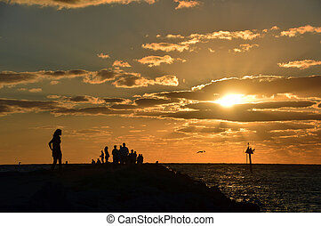 She stands alone at sunset - This is a photo of a lady (and...