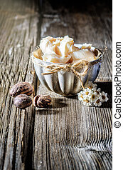Shea butter and nuts - Cup of shea butter with shea nuts on...