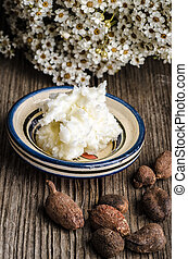 shea butter and nuts - Shea butter and nuts on a wooden...