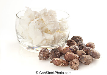shea nuts near butter, isolated on white background