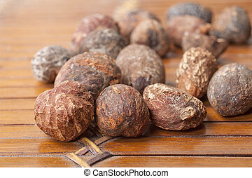 shea nuts near butter on white background - shea nuts near...
