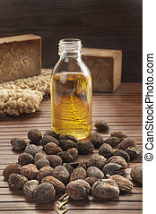 shea nuts on a natural background - shea nuts on a natural...
