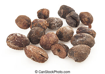 shea nuts on white background, karite seeds - shea nuts...