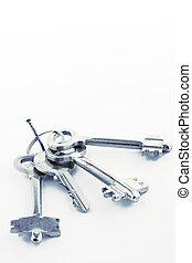 Sheaf of keys on a nail - Sheaf of keys  on white background