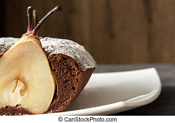 shear of whole chocolate cake with pear