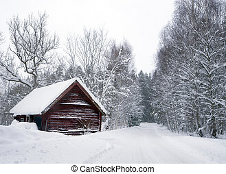 Shed in winter - Wooden shed in winter landscape by rural...