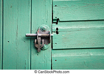Shed lock - Metal bolt lock on a blue painted shed door