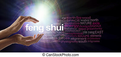 Shedding light on Feng Shui - Female hands cupped around the...
