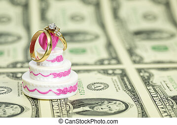 Sheel of money with a wedding cake and rings