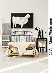 Sheep poster in bedroom interior
